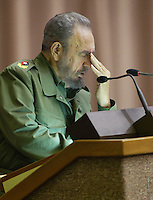 Cuban President Fidel Castro talking during a second session at the Cuban Parliament, in the Palace of Conventions, Friday, Dec. 23, 2005 in Havana, Cuba. . Credit: Jorge Rey/MediaPunch