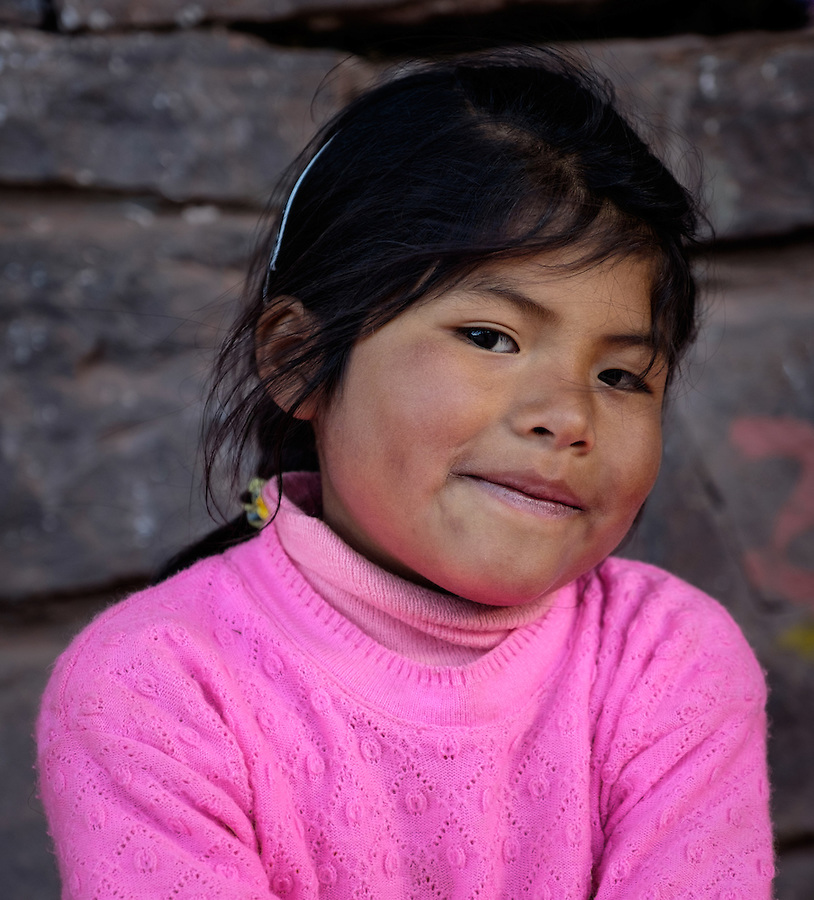 TAQUILE, PERU - CIRCA OCTOBER 2015: Portrait of girl in the Island of Taquile in Lake Titicaca.