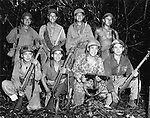 "December 1943 - Navajo ""Code Talkers"" serve with a Marine unit on Bourgainville. From left, front row: Pvt. Earl Johnny, Pvt. Kee Etsicitty, Pvt. John V. Goodluck and PFC David Jordon. Second row: Pvt. Jack C. Morgan, Pvt. George H. Kirk, Pvt. Tom H. Jones and Cpl. Henry Bake, Jr."