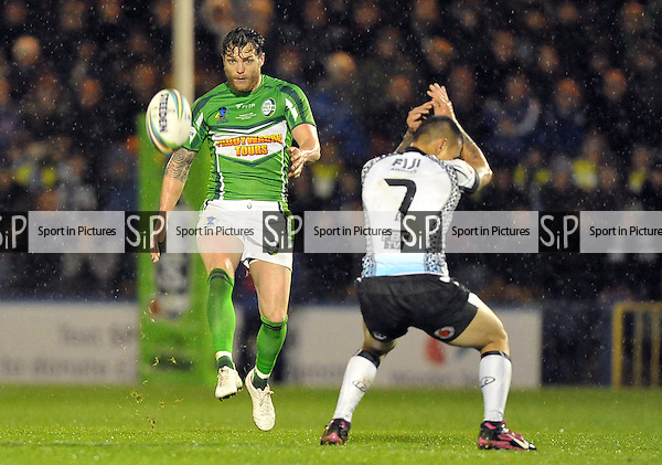 Scott Grix (Ireland) kicks as Aaron Groom (Fiji) takes cover  - PHOTO: Mandatory by-line: Garry Bowden/SIPPA/Pinnacle - Photo Agency UK Tel: +44(0)1363 881025 - Mobile:0797 1270 681 - VAT Reg No: 768 6958 48 - 28/10/2013 - Rugby League World Cup 2013, Fiji v Ireland, Spotland Stadium, Rochdale, England