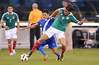 Mexico  Aldo De Nigris (9) shields the ball against Guatemala Gustavo Cabrera (6)   Mexico defeated Guatemala 2-1 in the quaterfinals for the 2011 CONCACAF Gold Cup , at the New Meadowlands Stadium, Saturday June 18, 2011.