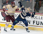 Ian McCoshen (BC - 3), Vince Hinostroza (ND - 13) - The visiting University of Notre Dame Fighting Irish defeated the Boston College Eagles 2-1 in overtime on Saturday, March 1, 2014, at Kelley Rink in Conte Forum in Chestnut Hill, Massachusetts.