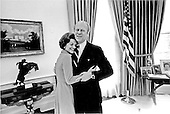 First lady Betty Ford shares a warm moment with her husband, United States President Gerald R. Ford after they had discussed her decorating improvements in the Oval Office at the White House in Washington, D.C. on December 6, 1974.  The room became brighter and had a more casual atmosphere.  A light rug from the Johnson Administration has replaced the formal blue carpet with the Presidential emblem that previously covered the floor.  A collection of family pictures has been added to the small table behind his desk near the windows of the Oval Office.<br /> Mandatory Credit: David Hume Kennerly / White House via CNP