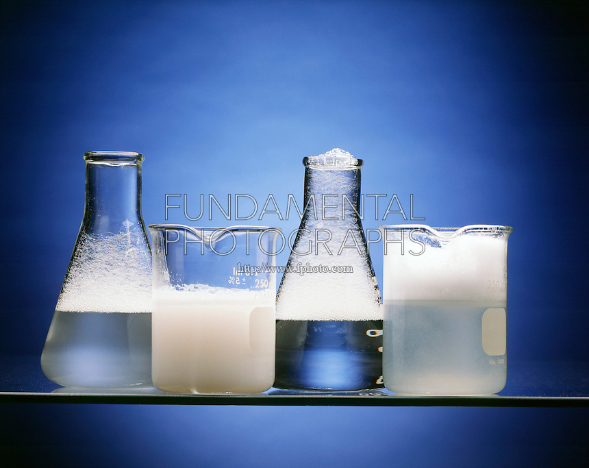 SUDSING PROPERTIES: SOAP &amp; DETERGENT<br /> Hard Water Versus Soft Water<br /> From left: detergent in hard water, soap in hard water, detergent in soft water, and soap in soft water. The sudsing of detergent differs little in hard water and soft waters. Note insoluble material in hard water.