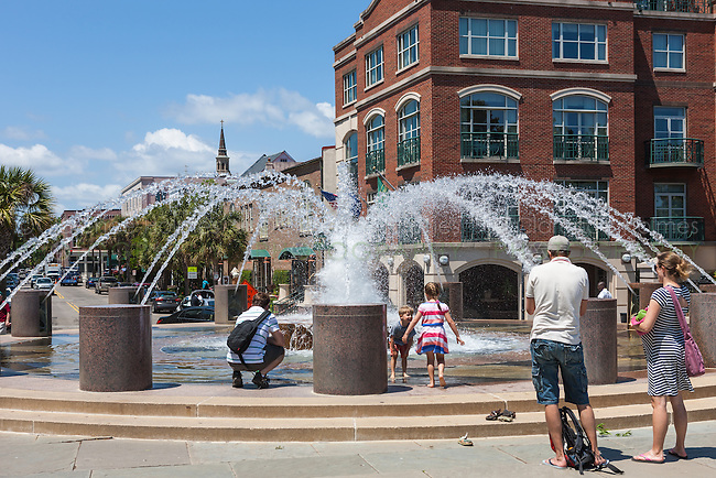 People enjoy one of the fountains in Waterfront Park in Charleston, South Carolina.