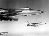 F-105 Thunderchiefs of the 355th Tactical Fighter Wing streak toward an enemy target in Southeast Asia carrying conventional bombs.  Since the November 1968 bombing halt of North Vietnam, the 355th has been striking enemy communication and supply lines in South Vietnam.   .Credit: U.S. Air Force via CNP