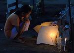 People mourn the dead buried in a church yard following the passage of Typhoon Haiyan through the city of Palo, in the Philippines province of Leyte, in November 2013. The storm was known locally as Yolanda.