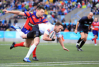 TORONTO, ON - MAY 06:  Ryan Brierley #27 of Toronto Wolfpack scores a try as he is tackled by Harvey Burnett #3 of Oxford RLFC during the first half of a Kingstone Press League 1 match at Lamport Stadium on May 6, 2017 in Toronto, Canada.  (Photo by Vaughn Ridley/SWpix.com)