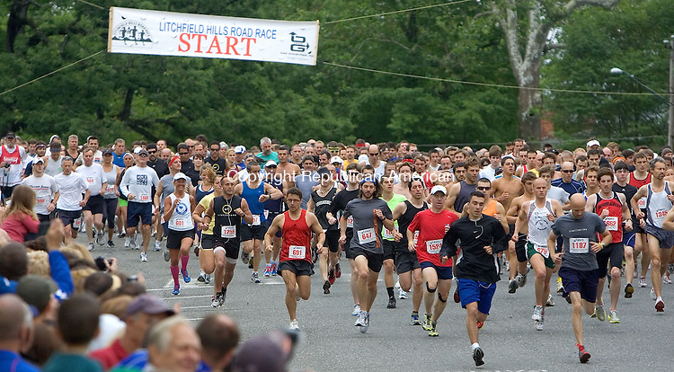 LITCHFIELD, CT. 12 June 2011-061211SV01--Runners take off at the start of the 35th annual Litchfield Hills Road Race in Litchfield Sunday..Steven Valenti Republican-American