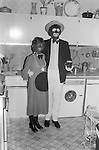 1980's British middle class society. Christmas Fancy Dress Party London. Couples dressed as the Black and White Minstrels a popular on television of the time.