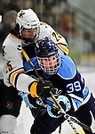 2 December 2011: University of Maine Black Bear forward Joey Diamond, a Junior from Long Beach, NY, works against University of Vermont Catamount defenseman Nick Luukko, a Freshman from West Chester, PA, at Gutterson Fieldhouse in Burlington, Vermont. The Catamounts fell to the Black Bears 6-4 in the first game of their 2-game Hockey East weekend series. Mandatory Credit: Ed Wolfstein Photo