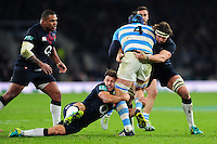 Danny Care and Tom Wood of England double-tackle Guido Petti of Argentina. Old Mutual Wealth Series International match between England and Argentina on November 26, 2016 at Twickenham Stadium in London, England. Photo by: Patrick Khachfe / Onside Images