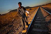 "A Guatemalan immigrant waits on the railroad track to climb up the cargo train passing through the train station in Huehuetoca, Mexico, 7 November 2014. Between 2010 and 2015, the US and Mexico have apprehended almost 1 million illegal immigrants from El Salvador, Honduras, and Guatemala. While the economic reasons remain the most frequent motivation for people from Central America to illegally immigrate to the US, thousands of Salvadorans, Guatemalans, and Hondurans, many of them minors, seek asylum in the US due to the thriving crime and gang-related violence in their region (known as the Northern Triangle). Taking an exhausting and risky journey, riding thousands of miles atop the cargo trains, facing a physical danger and extortion from the organized crime groups that control migrant routes, the ""undocumented"" still flee to the US, looking for their American dream."