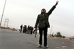 Opposition fighters were tense at the Brega checkpoint, moments before it was hit by heavy artillery, Brega, Libya, March, 13, 2011. Fighting between rebels and the forces of Col. Muammar Qaddafi continued, with steadily pulling back.