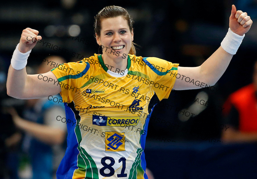BELGRADE, SERBIA - DECEMBER 20:  Deonise Cavaleiro of Brazil celebrates the goal reacts during the World Women's Handball Championship 2013 Semi Final match between Brazil and Denmark at Kombank Arena Hall on December 20, 2013 in Belgrade, Serbia. (Photo by Srdjan Stevanovic/Getty Images)