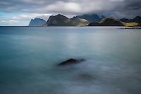 Storsandnessanden beach looking towards mountains of Vestvagoy, Lofoten Islands, Norway