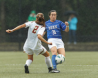 Duke University defender Christina Gibbons (31) passes the ball.Boston College (white) defeated Duke University (blue/white), 4-1, at Newton Campus Field, on October 6, 2013.