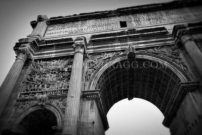 Black and White photo of the historic Arch of Septimius Severus in the Roman Forum in Italy.