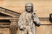 Statue of Voltaire, writer, historian and philosopher of the Enlightenment, 1694-1778, by Antoine Desboeufs at the Colbert Wing, in the Cour Napoleon at the Musee du Louvre, Paris, France. A series of 86 statues of famous men were placed in this courtyard 1853-57 under the architects Louis Visconti and Hector Lefuel. Picture by Manuel Cohen