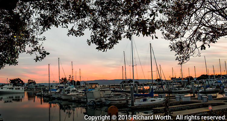 "According to legend, this sunset bodes well for sailors who'll launch their boats in the morning "" Red sky at night, sailor's delight. . . ""  San Leandro Marina on San Francisco Bay, on March 14th - Pie Day, 2015."
