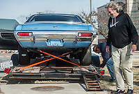 NWA Democrat-Gazette/ANTHONY REYES @NWATONYR<br /> Jerry Taplin (right), owner of Cars, Guitars and Antiques, and Jack Davis load a 1972 Ford Gran Torino Friday, Feb. 10, 2017 onto a trailer near his shop in downtown Bentonville. Tapin plans on trading the Torino for a 1946 Chrysler New Yorker.