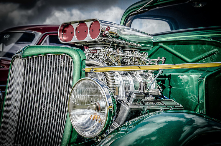 Classic American muscle car in green with chrome engine