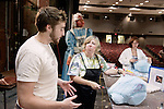 Nick Brokaw, left, a OU theater design major, works with Martha Marking of Appalachian State University on designing a straforam bunny head...