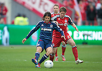 21 April 2012: Chicago Fire midfielder Sebastian Grazzini #10 and Toronto FC midfielder Terry Dunfield #23 in action during the first half in a game between the Chicago Fire and Toronto FC at BMO Field in Toronto...