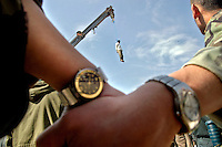 Serial killer Mohammad Bijeh, 22, who was convicted of kidnapping and murdering 21 people, most of them children, is hauled into the air hanging from the arm of a crane after his execution on March 16, 2005. Bijeh, branded 'the vampire of the desert' in Iran, was lashed 100 times and hanged before thousands of spectators.