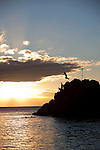"""In Hawaiian, this place is known as Pu'u Kaka'a which at one point in ancient times housed a heiau (temple) and is a sacred spot known as """"ka leina a ka 'uhane,"""" a place were a soul leaps into eternity.  Most evenings a diver from the Sheraton Maui resort dives into the ocean from the rocks after lighting torches to honor the souls of the departed.  This evening, in addition to the torch lighter, a group of locals enjoyed diving off the rocks into the beautiful evening sea."""