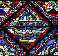 Noah releasing a dove through a window in the ark after 40 days of flood, from the Life of Noah stained glass window, 13th century, in the nave of Chartres cathedral, Eure-et-Loir, France. Chartres cathedral was built 1194-1250 and is a fine example of Gothic architecture. Most of its windows date from 1205-40 although a few earlier 12th century examples are also intact. It was declared a UNESCO World Heritage Site in 1979. Picture by Manuel Cohen