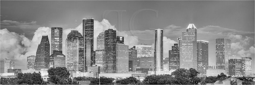 This black and white panorama image of Houston, Texas, is a stitch of several photographs. Taken on a warm September evening, large thunderheads were building in the distance, adding drama to the view of downtown over the largest city in the Lone Star State. This photograph of H-town was captured from the roof of a nearby building and looks east as the sun was beginning to fade behind me.