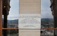 Plaque at the entrance to the National and University Library of Bosnia and Herzegovina, commemorating the fire in 1992 during the Siege of Sarajevo in the Yugoslav War, when the building and over 2 million books and documents were damaged or destroyed, Sarajevo, Bosnia and Herzegovina. This national library, designed in 1891 by the Czech architect Karel Parik as the City Hall, reopened as a library in 2014. This building, on the banks of the Miljacka river, is from the Austro-Hungarian period of the city. Picture by Manuel Cohen