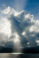 The early monring sun shines through a cloud off the coast of Saint Lucia.