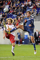 Stephen Keel (22) of the New York Red Bulls and Adam Cristman (17) of the Los Angeles Galaxy. The New York Red Bulls defeated the Los Angeles Galaxy 2-0 during a Major League Soccer (MLS) match at Red Bull Arena in Harrison, NJ, on October 4, 2011.
