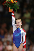 Sept 8, 2007; Stuttgart, Germany; Ksenia Semenova of Russia celebrates winning gold in women's artistic gymnastics uneven bars event final at 2007 World Championships. Photo by Tom Theobald. Copyright 2007 by Tom Theobald
