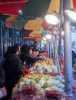 Fruit seller in Chinatown in New York on Sunday, March 30, 2014. (© Richard B. Levine)