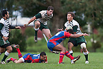 Mark Selwyn jumps over Whaiora Rangiwai as he arrives to lend assistance  to Tim Nanai-Williams. Counties Manukau Premier Club Rugby game between Manurewa and Ardmore Marist played at Mountfort Park, Manurewa on Saturday June 19th 2010..Manurewa won the game 27 - 10 after leading 15 - 5 at halftime.