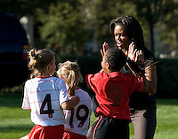 Michelle Obama high fives a Soccer Sisters United player during a Lets Move! soccer clinic held on the South Lawn of the White House.  Let's Move! was started by Mrs. Obama as a way to promote a healthier lifestyle in children across the country.