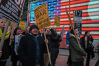 NEW YORK, NY - APRIL 07 : Demonstrators gather at  Times Square at rally to condemn the U.S. Bombing of Syria. The United States launched a military strike Thursday on a Syrian government airbase in response to a chemical weapons attack that killed dozens of civilians earlier in the week. In New York City on April 07, 2017. VIEWpress/Maite H. Mateo