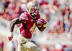 Florida State running back Dalvin Cook eyes the endzone as he makes a 14 yard touchdown run in the second half of an NCAA college football game against Louisville in Tallahassee, Fla., Saturday, Oct. 17, 2015. Florida State defeated Louisville 41-21. (AP Photo/Mark Wallheiser)