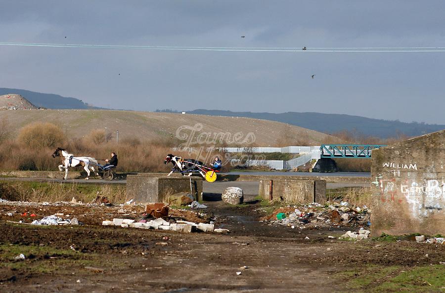 Sulkeys race through waste ground in Saint Marys Park Limerick.