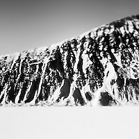 A snow covered rock face south of Daneborg.