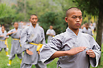 Students of Shaolin martial arts school practicing Qi Gong outside at the opening ceremony of Zhengzhou International Wushu Fetival in DengFeng, Henan, China 2014