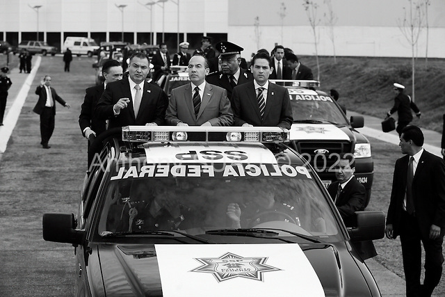 Mexico City, Mexico<br /> June 16, 2008<br /> <br /> (L-R) Secretary of Public Security Genaro Garcia Luna, Mexico's President Felipe Calderon and Interior Minister Juan Camilo Mourino tour, by truck, the opening of a new federal police center. The first of ten scheduled to open around the country.