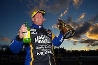 Nov 15, 2015; Pomona, CA, USA; NHRA pro stock driver Allen Johnson celebrates after winning the Auto Club Finals at Auto Club Raceway at Pomona. Mandatory Credit: Mark J. Rebilas-USA TODAY Sports