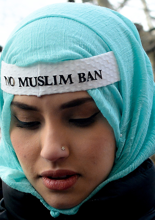 A Muslim woman wears a band aide on her forehead to protest President Donald Trump's Travel Ban on people from Muslim country on Sunday, Janurary, 29, 2017.