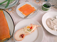 Switzerland. Canton Ticino. Lugano. Christmas meal. Smoked salmon, crayfish with egg and mayonnaise and vitello tonato. 24.12.12 © 2012 Didier Ruef
