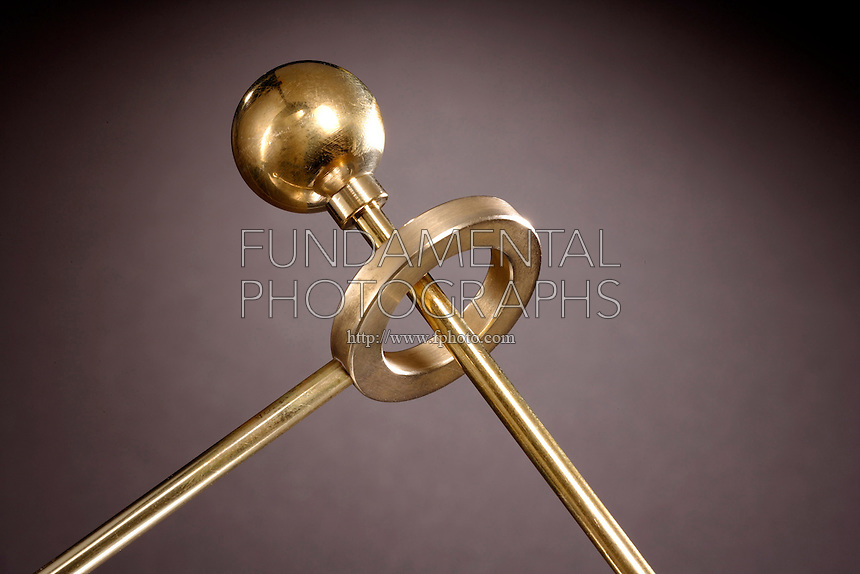 THERMAL EXPANSION: BALL &amp; RING<br /> Ball Passes Through Ring At Room Temperature<br /> This brass ball fits easily through the matching ring when they are both at room temperature. Heat the ball in a flame, and it expands so that it no longer fits through.