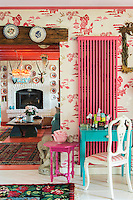 Brightly painted wall-mounted radiators are a feature of the colourful living room